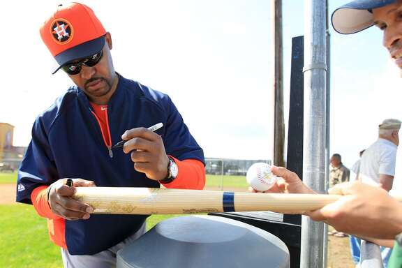 Houston Astros manager Bo Porter (16) signs autographs for fans at the Oseola County Stadium, Tuesday, Feb. 12, 2013, in Kissimmee, as pitchers and catchers get their first official workout completed on the first day of spring training.  ( Karen Warren / Houston Chronicle )