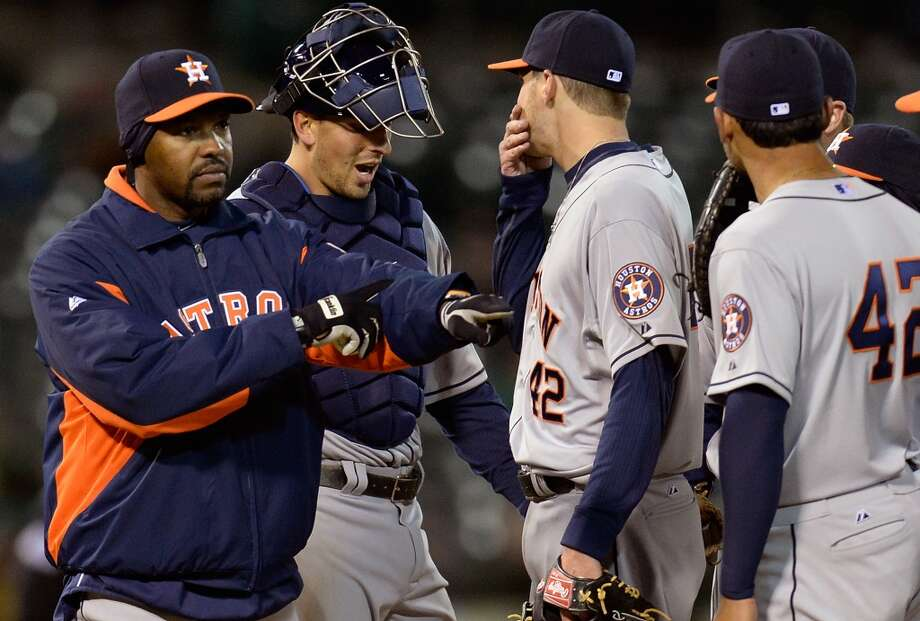 OAKLAND, CA - APRIL 15:  Manager Bo Porter (L) of the Houston Astros signals the bullpen to make a pitching change taking Paul Clemens (C) out of the game against the Oakland Athletics in the six inning at O.co Coliseum on April 15, 2013 in Oakland, California. All uniformed team members are wearing jersey number 42 in honor of Jackie Robinson Day.  (Photo by Thearon W. Henderson/Getty Images) Photo: Thearon W. Henderson, Getty Images