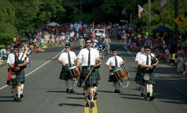 Jack Lotko, 44, of Cheshire, leads the Gaelic Highland Pipe Band, of North Haven, down Main Street during the 53rd Annual Labor Day Parade in Newtown, Conn, on Monday, September 1, 2014. Photo: H John Voorhees III / The News-Times Freelance