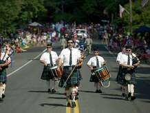 Jack Lotko, 44, of Cheshire, leads the Gaelic Highland Pipe Band, of North Haven, down Main Street during the 53rd Annual Labor Day Parade in Newtown, Conn, on Monday, September 1, 2014.