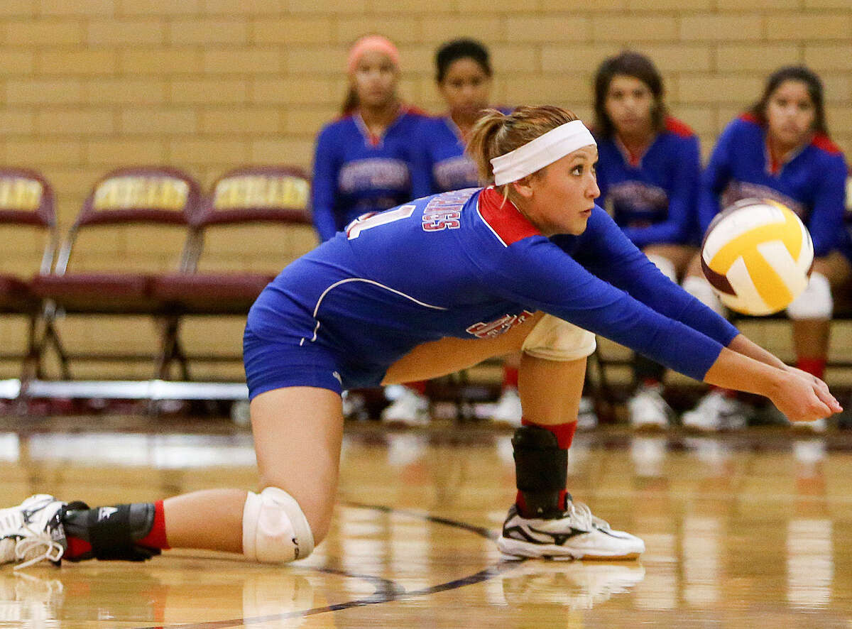 Jefferson's Gabriella Vasquez digs a ball in the backcourt during the Mustangs' contest with the Indians at Harlandale last week. Jefferson swept Harlandale at the match.