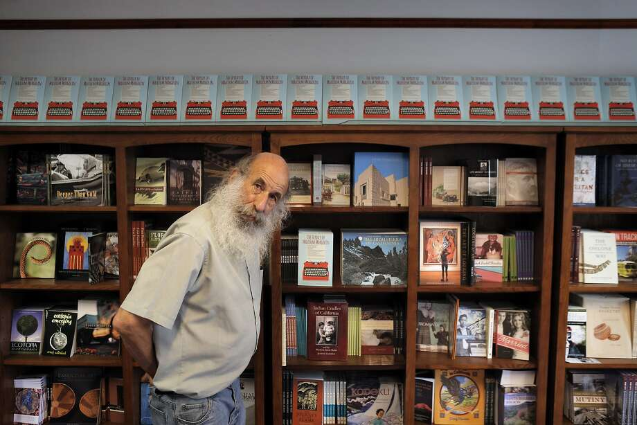 Malcolm Margolin with some of the Heydey's many books. Photo: Carlos Avila Gonzalez, The Chronicle