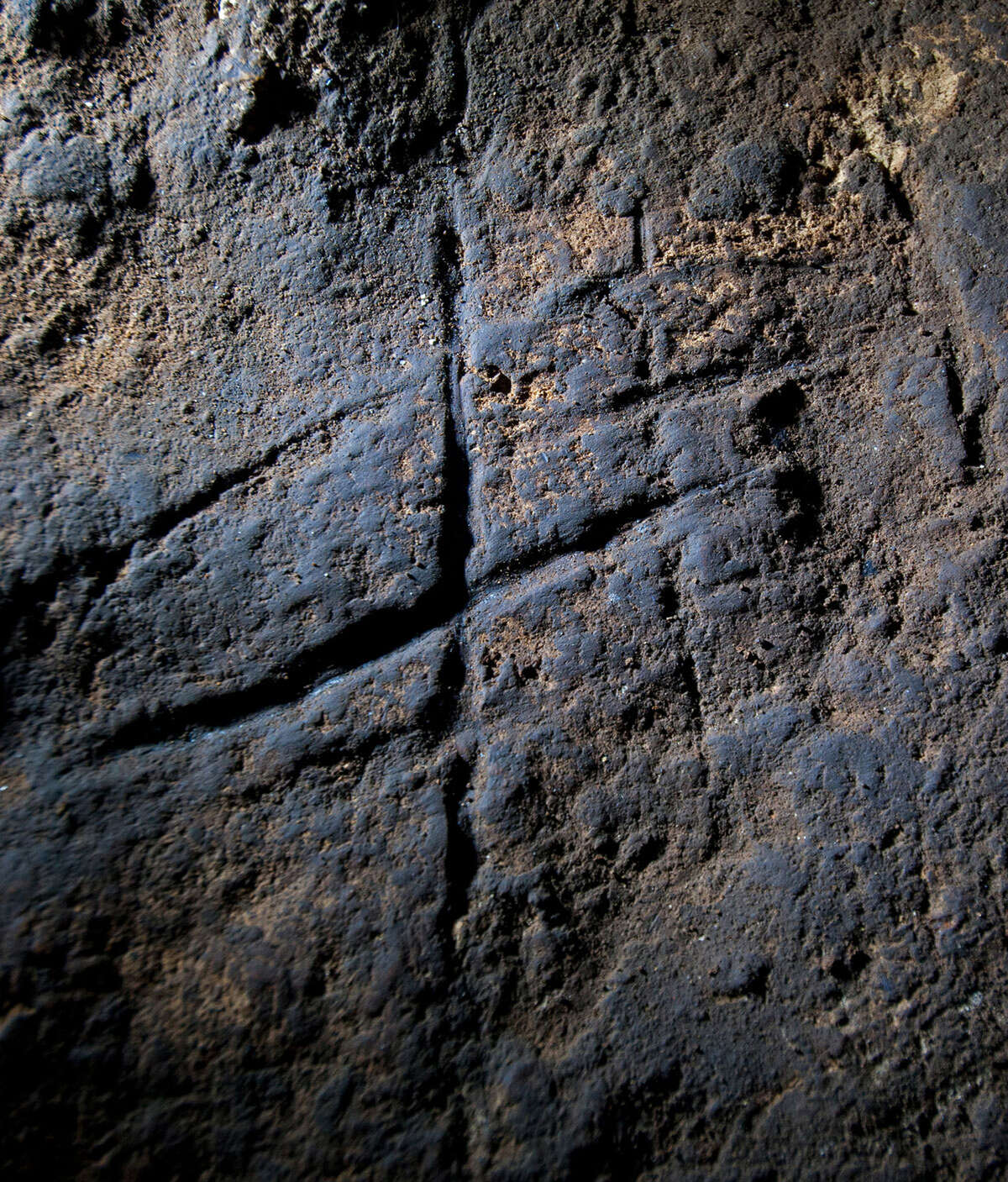 This undated image provided by Journal shows a Neanderthal rock engraving at Gorham's Cave in Gibraltar. The series of lines scratched into the rock could be proof that Neanderthals were more intelligent and creative than previously thought.AP story: Study claims cave art made by Neanderthals