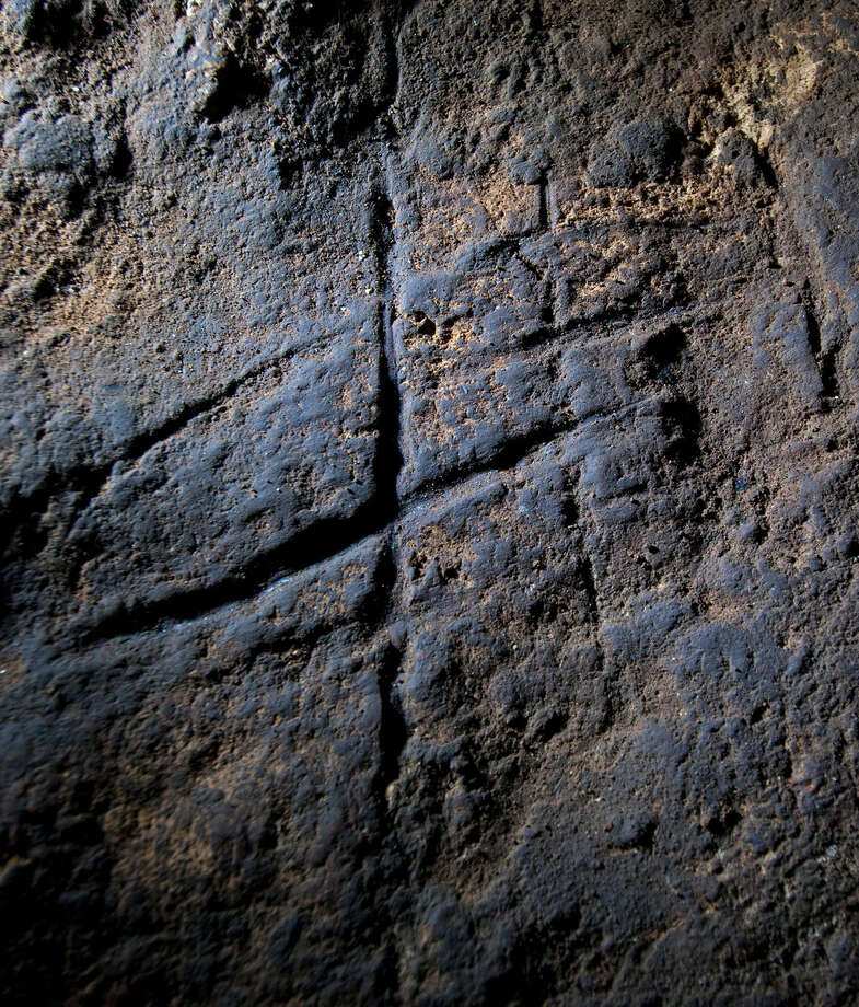 This undated image provided by Journal shows a Neanderthal rock engraving at Gorham's Cave in Gibraltar. The series of lines scratched into the rock could be proof that Neanderthals were more intelligent and creative than previously thought.AP story: Study claims cave art made by Neanderthals Photo: Stuart Finlayson, AP / Stuart Finlayson via Journal
