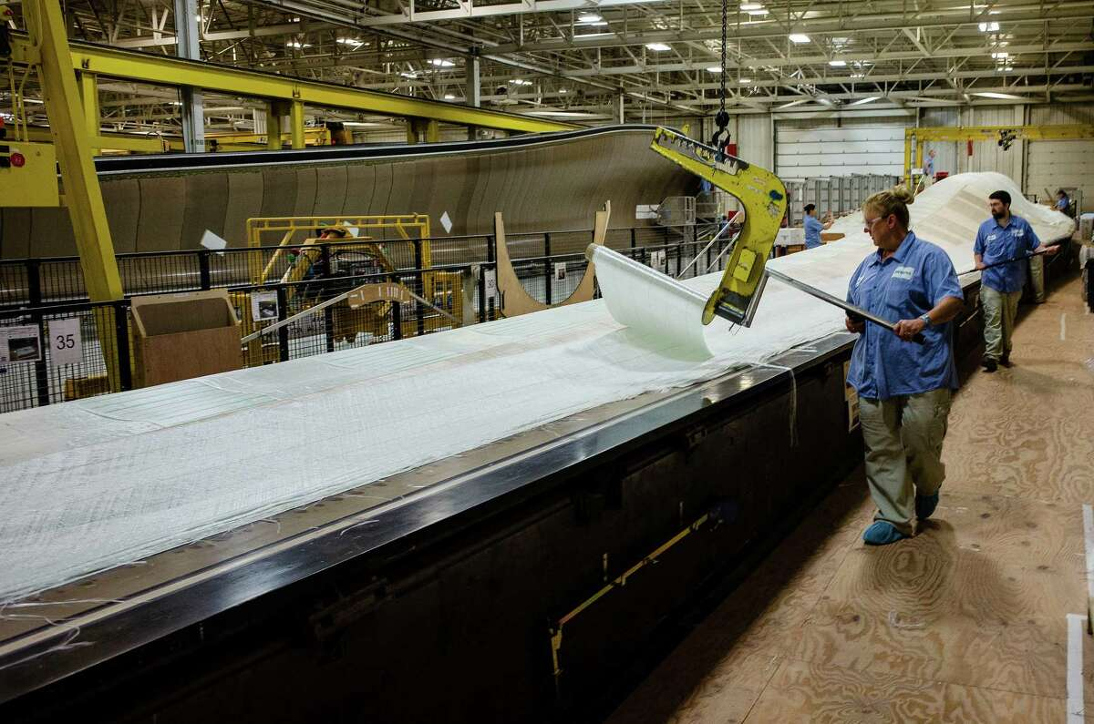 A worker rolls fiberglass fabric onto a blade mold at the Siemens AG turbine blade plant in Fort Madison, Iowa. The U.S. Export-Import Bank agreed to lend $65 million for Peruvian wind farms that will use Siemens AG turbines made in Fort Madison and at another Siemens plant in Kansas. The bank helps the U.S. compete globally.