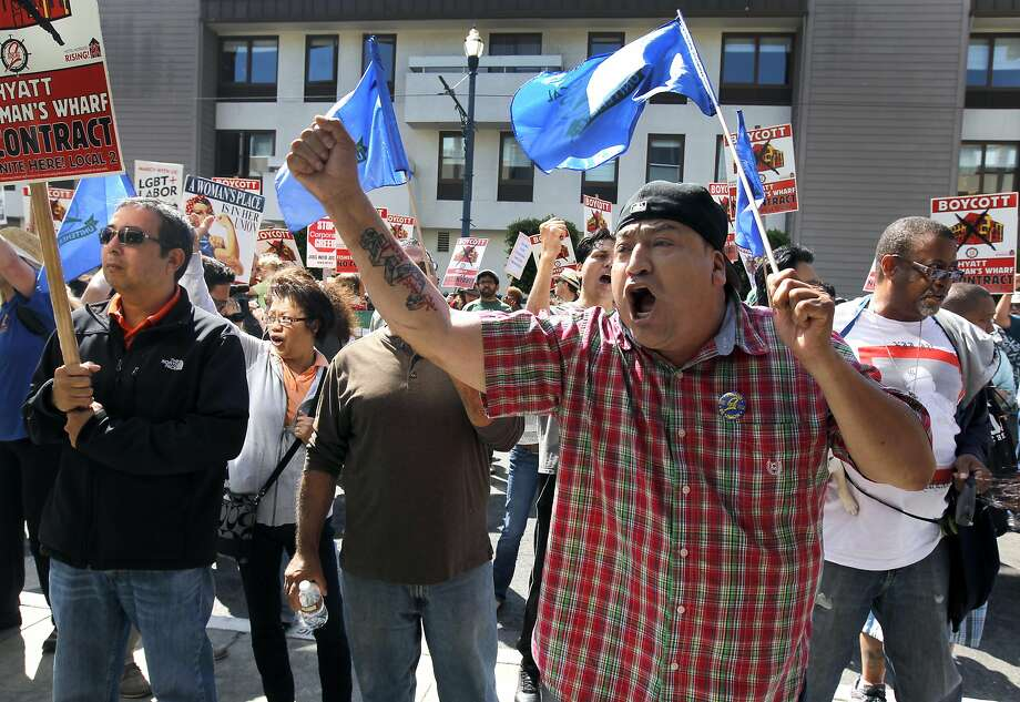 Arturo Marquez, who works at the Hotel Vitale, marches with other hotel workers and labor leaders at the Hyatt Fisherman's Wharf. Photo: Paul Chinn, The Chronicle