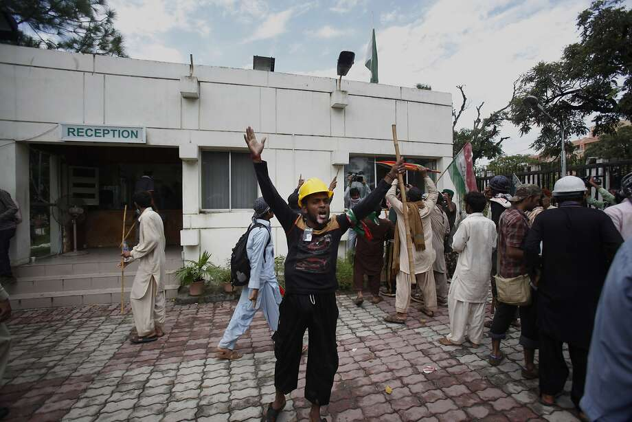 Protesters briefly took over Pakistan's state television station in Islamabad, forcing the channel off the air. Hundreds were wounded in weekend clashes. Photo: Anjum Naveed, Associated Press