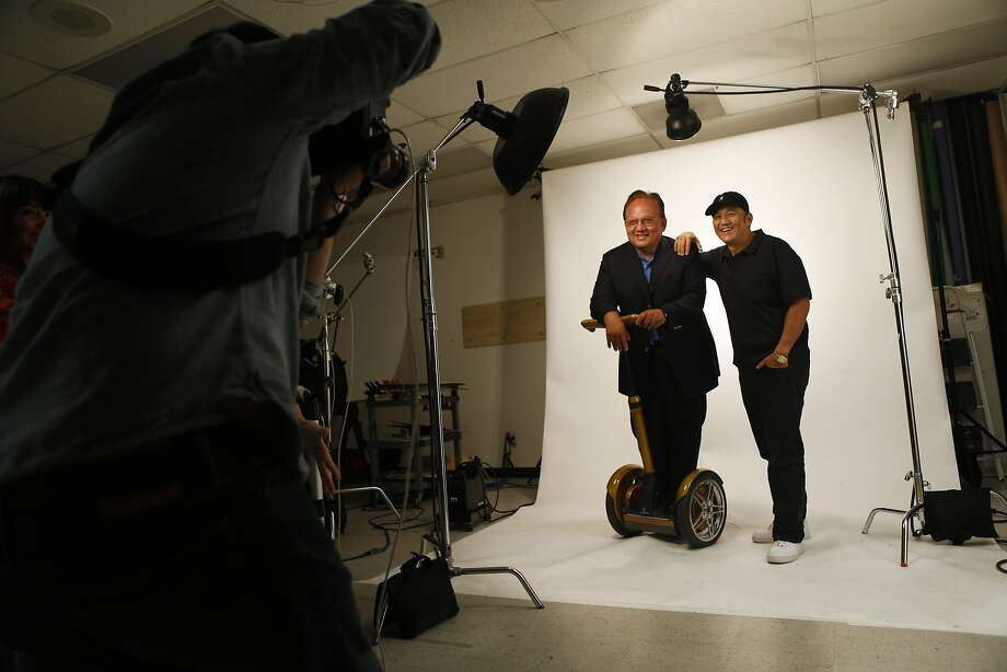 Father-and-son headphone wizards Noel and Kevin Lee have their portrait taken by Monster Products' Tom Penpark. The Lees' technology helped drive the popularity of chunky, audiophile-style headphones. Photo: Scott Strazzante, The Chronicle