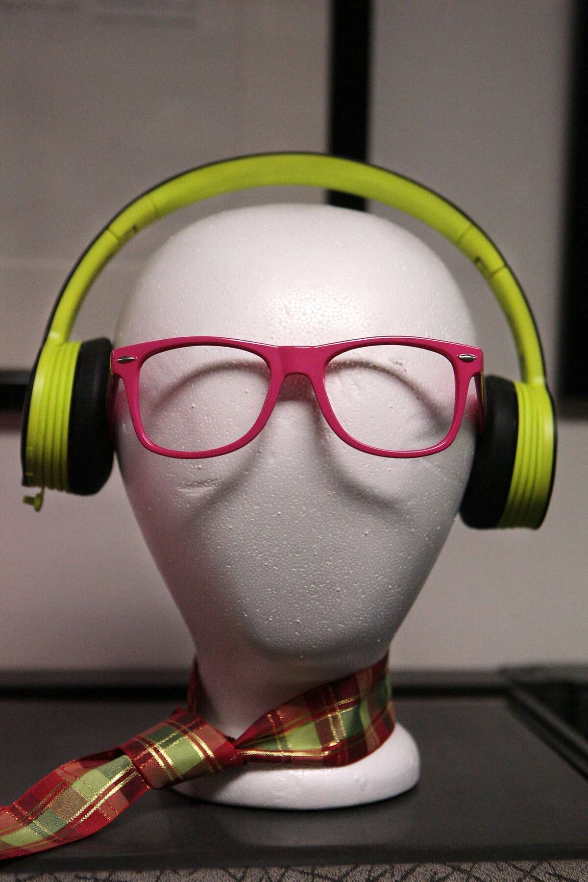 A styrofoam mannequin head holds colorful pairs of glasses and headphones Noel Lee at the headquarters of audio/video cable company Monster on Monday, July 28, 2014 in Brisbane, Calif.