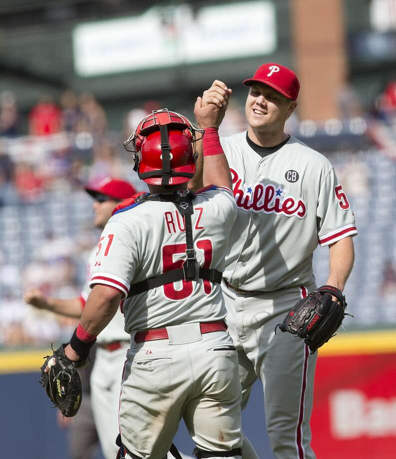 Philadelphia closer Jonathan Papelbon and catcher Carlos Ruiz celebrate after the last out. Photo: John Bazemore, Associated Press