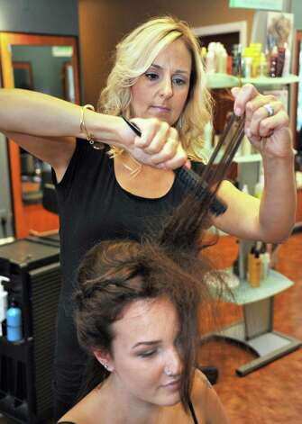 Cassondra Schauble, top, styles Sierra Huskie's hair at Changes Salon Tuesday August 26, 2014, in Colonie, NY.  (John Carl D'Annibale / Times Union) Photo: John Carl D'Annibale / 00028338A