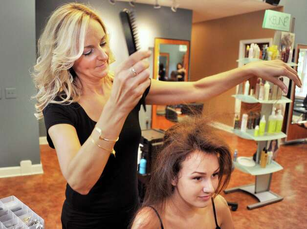 Cassondra Schauble, left, styles Sierra Huskie's hair at Changes Salon Tuesday August 26, 2014, in Colonie, NY.  (John Carl D'Annibale / Times Union) Photo: John Carl D'Annibale / 00028338A