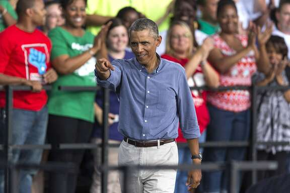 MILWAUKEE, WISCONSIN - SEPTEMBER 1:  U.S. President Barack Obama points to the audience after speaking during  Laborfest 2014 at Henry Maier Festival Park September 1, 2014  in Milwaukee, Wisconsin. Obama again called for the raising of the minimum wage.  (Photo by Tom Lynn/Getty Images)