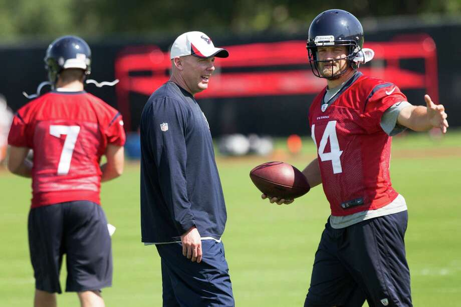 New quarterbacks coach George Godsey, left, is embracing the chance to work with Ryan Fitzpatrick and the Texans' other signal-callers. Photo: Brett Coomer, Staff / © 2014 Houston Chronicle