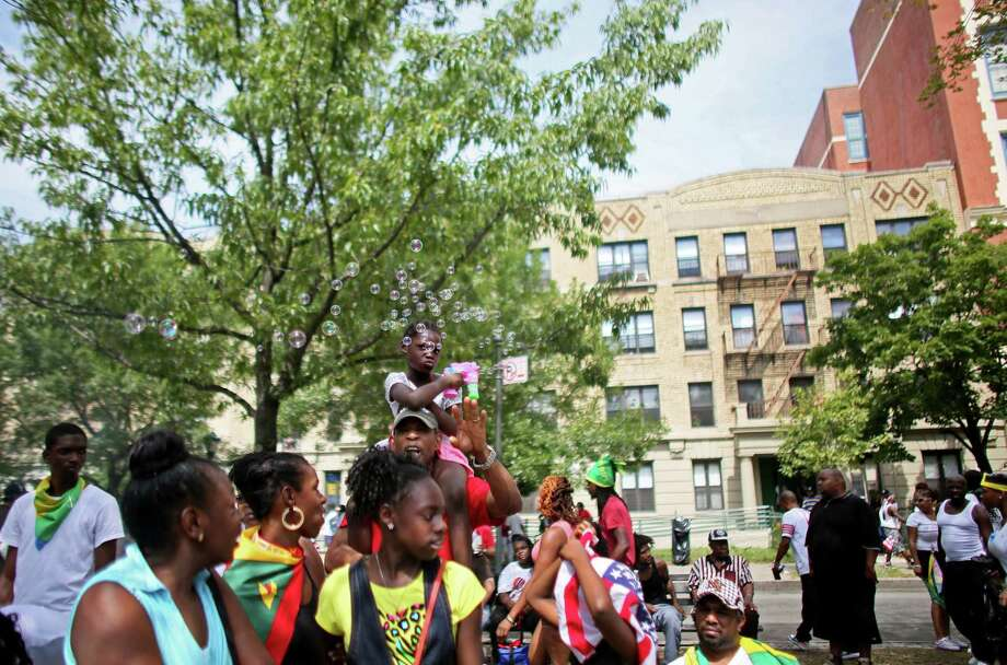 Revelers participate in the annual West Indian Day parade held on September 1, 2014 in the Brooklyn borough of New York City. The parade, which draws a crowd of a million plus, celebrates Caribbean culture. Photo: Yana Paskova, Getty Images / 2014 Getty Images