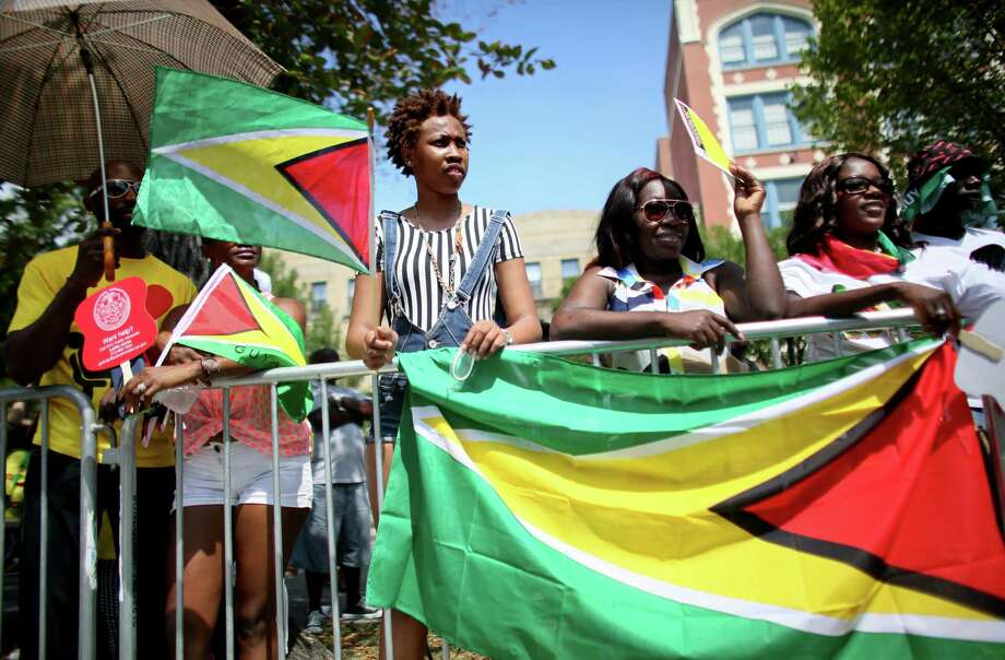 Visitors watch the annual West Indian Day parade held on September 1, 2014 in the Brooklyn borough of New York City. The parade, which draws a crowd of a million plus, celebrates Caribbean culture. Photo: Yana Paskova, Getty Images / 2014 Getty Images