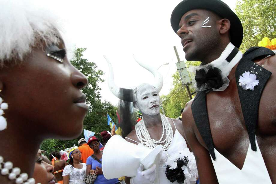 Dressed for the occasion, Curtis Noel, center, and others wait to take part in the West Indian Day Parade, Monday, Sept. 1, 2014 in the Brooklyn borough of New York. Photo: Tina Fineberg, Associated Press / FR73987 AP