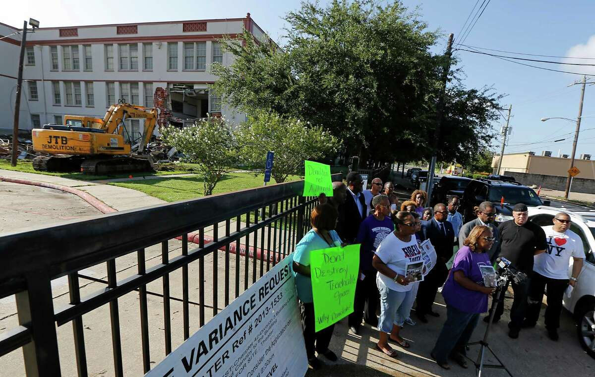 Neighborhood activists protest destruction to the old Wheatley school in the Fifth Ward on Monday.