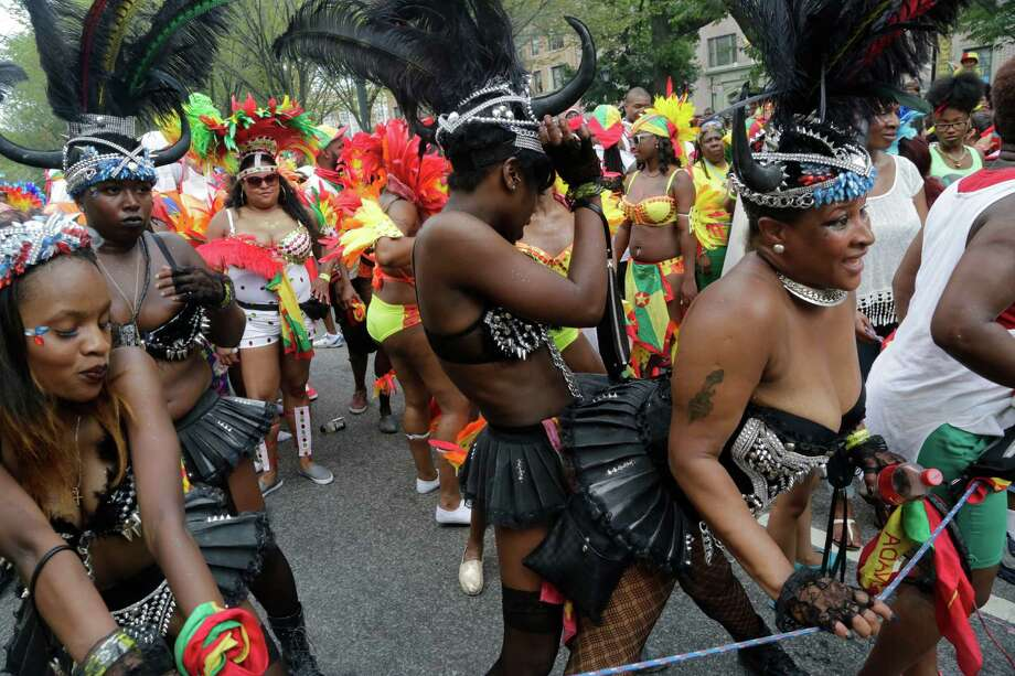 Dancers perform for spectators during the West Indian Day Parade, Monday, Sept. 1, 2014 in the Brooklyn borough of New York.  Photo: Mark Lennihan, Associated Press / AP