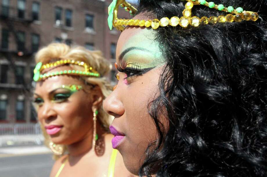 Dressed for the occasion, Diamond Powell, right, and her mother Natalie Brown wait to take part in the West Indian Day Parade Monday Sept. 1, 2014 in the Brooklyn borough of New York.  Photo: Tina Fineberg, Associated Press / FR73987 AP