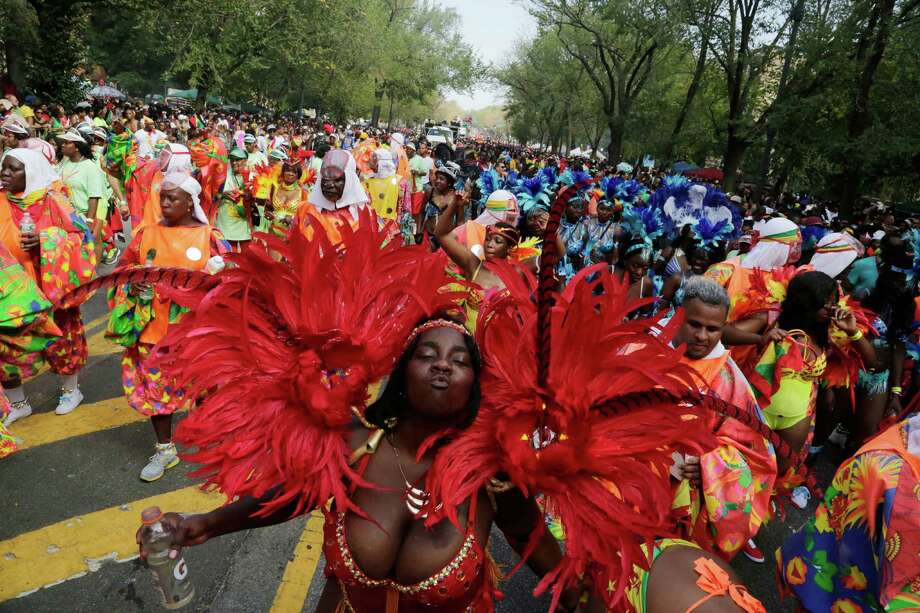 A dancer poses for a photograph during the West Indian Day Parade, Monday, Sept. 1, 2014 in the Brooklyn borough of New York.  Photo: Mark Lennihan, Associated Press / AP