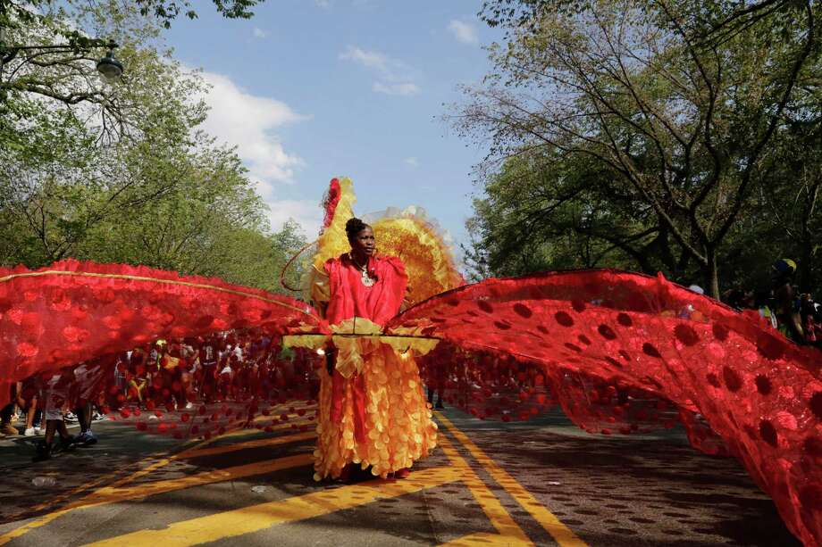 Esther Morgan, originally from Granada, bears a large costume as she marches down Eastern Parkway during the West Indian Day Parade, Monday, Sept. 1, 2014 in the Brooklyn borough of New York.  Photo: Mark Lennihan, Associated Press / AP