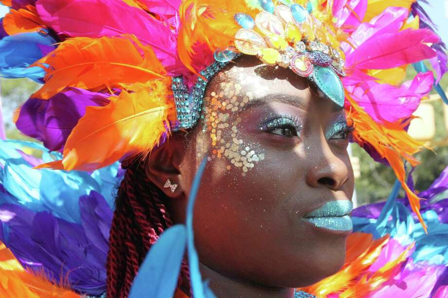 Dressed for the occasion, Shaleca Whyte waits to take part in the West Indian Day Parade, Monday, Sept. 1, 2014 in the Brooklyn borough of New York.  Photo: Tina Fineberg, Associated Press / FR73987 AP