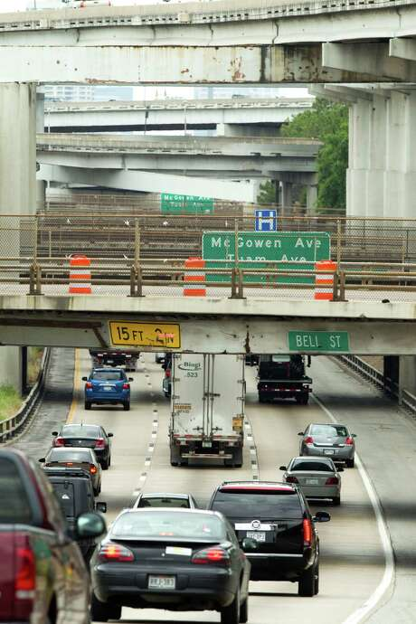 Vehicles drive in the southbound lanes of U.S. 59 under the Bell Street bridge Friday, April 13, 2012, in Houston. The southbound lanes of U.S. 59 will be closed over the weekend, between Interstate 10 to I-45 until 5 a.m. Monday. Texas Department of Transportation said the closure is necessary for crews to repair the Bell Street bridge, which will also be closed. ( Brett Coomer / Houston Chronicle ) Photo: Brett Coomer, Houston Chronicle / © 2012 Houston Chronicle