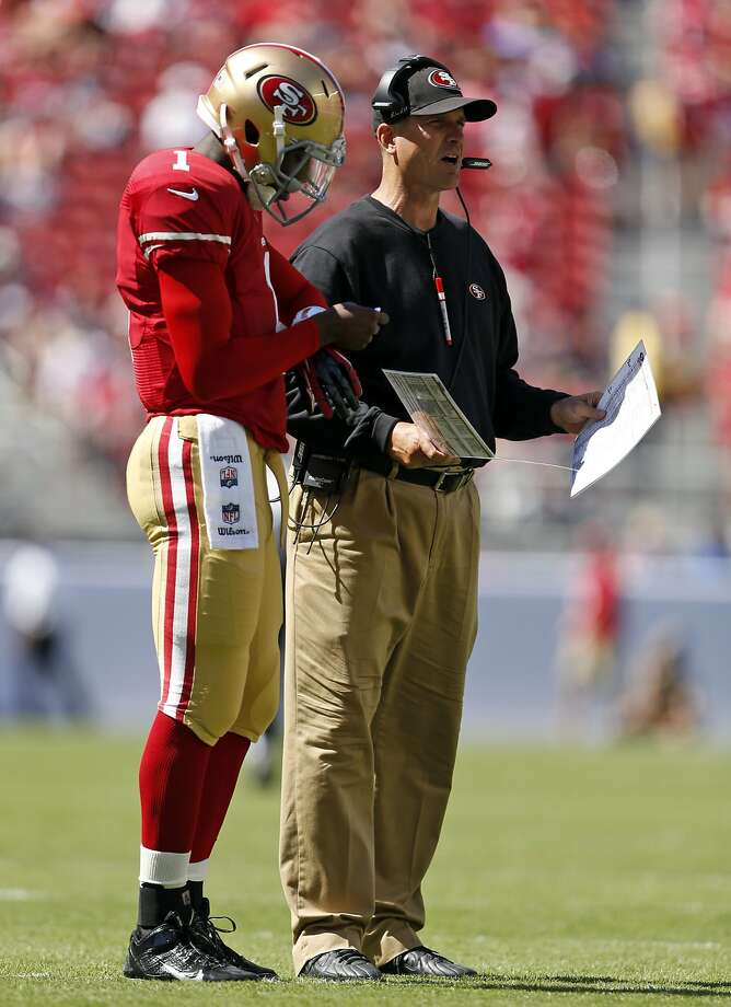 San Francisco 49ers' head coach Jim Harbaugh and quarterback Josh Johnson during 4th quarter of 34-0 loss to Denver Broncos during NFL preseason game at Levi's Stadium in Santa Clara, Calif. on Sunday, August 17, 2014. Photo: Scott Strazzante, The Chronicle