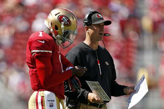 San Francisco 49ers' head coach Jim Harbaugh and quarterback Josh Johnson during 4th quarter of 34-0 loss to Denver Broncos during NFL preseason game at Levi's Stadium in Santa Clara, Calif. on Sunday, August 17, 2014.