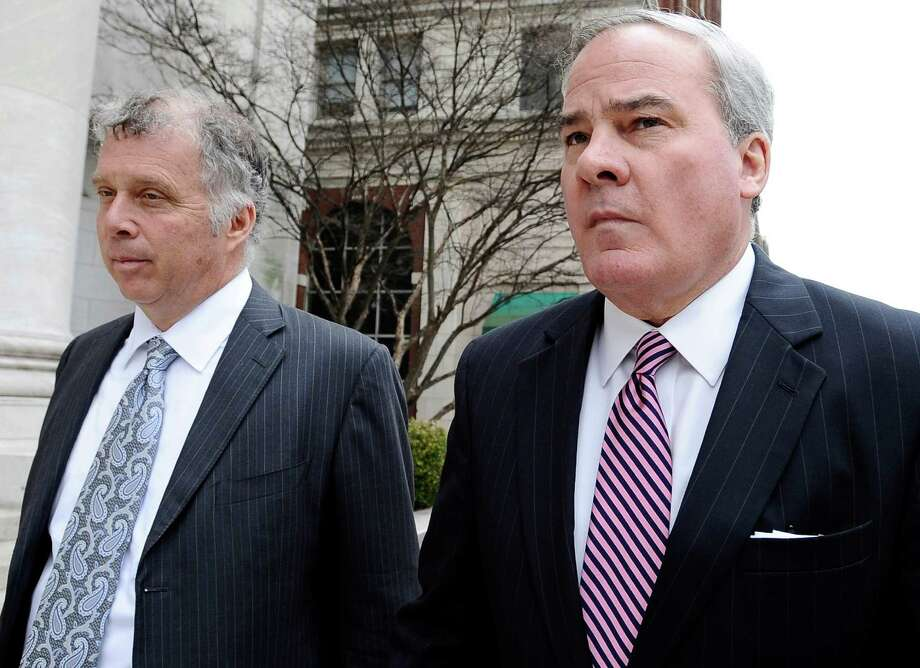 FILE - In this April 11, 2014 file photo, former Connecticut Gov. John G. Rowland, right, arrives with attorney Reid Weingarten at federal court in New Haven, Conn. Rowland faces charges he schemed to conceal involvement with congressional campaigns. His lawyers filed new arguments Monday night, June 30, 2014, seeking to have much of the case dismissed, contending that some of the federal charges he faces are unconstitutional. (AP Photo/Jessica Hill, File) Photo: Jessica Hill, Associated Press / Associated Press