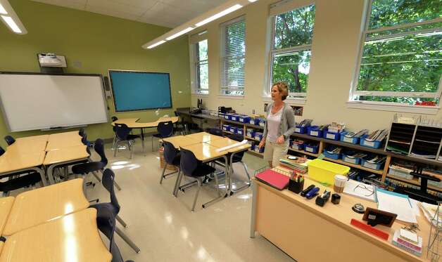 Kathy Constantine sets up her fifth grade classroom at the newly renovated Malta Avenue Elementary School Thursday afternoon, Aug. 28, 2014, in Ballston Spa, N.Y.   (Skip Dickstein/Times Union) Photo: SKIP DICKSTEIN / 00028357A