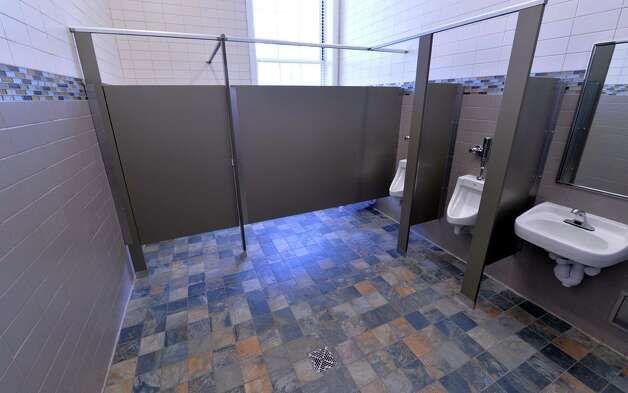 Interior view of a boys' restroom with tile floors and tile accents on the walls at the newly renovated Malta Avenue Elementary School Thursday afternoon, Aug. 28, 2014, in Ballston Spa, N.Y.   (Skip Dickstein/Times Union) Photo: SKIP DICKSTEIN / 00028357A