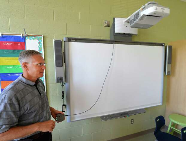 Malta Avenue Elementary School project manager, Bill McMordie shows off some the new technology at the newly renovated Malta Avenue Elementary School Thursday afternoon, Aug. 28, 2014, in Ballston Spa, N.Y.   (Skip Dickstein/Times Union) Photo: SKIP DICKSTEIN / 00028357A