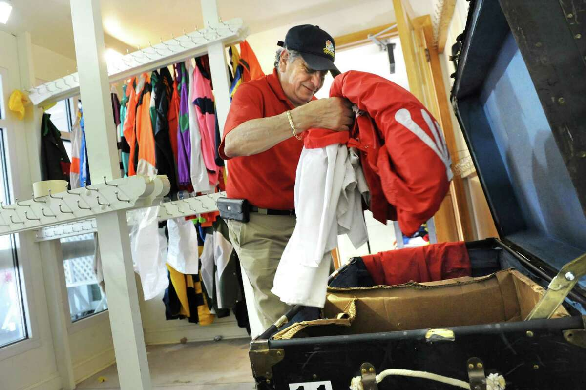 Colorman Walter Arce packs up jockey silks on the final day of thoroughbred races on Monday, Sept. 1, 2014, at Saratoga Race Course in Saratoga Springs, N.Y. (Cindy Schultz / Times Union)
