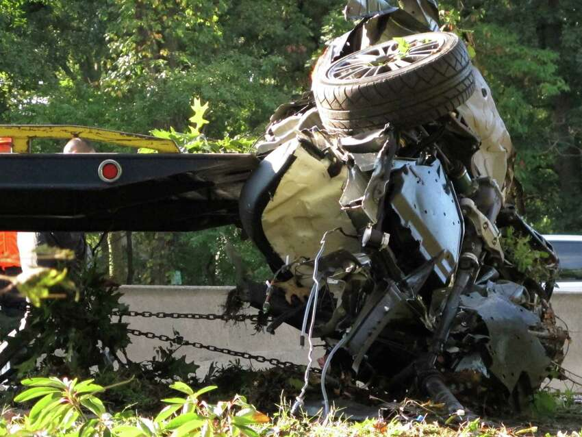 FILE - This Oct. 8, 2012 file photo shows the wrecked Subaru Impreza in which four people died as it is loaded onto a flatbed truck on the Southern State Parkway in West Hempstead, N.Y., after and early-morning accident. At the wheel was a New York teenager, Joseph Beer, who had smoked about $20 worth of marijuana, before getting into the car with four friends, and driving over 100 mph before crashing into trees with such force that it split the car in half. As states liberalize their marijuana laws, public officials and safety advocates worry that more drivers high on pot will lead to a spike in traffic deaths. Researchers who have studied the issue, though, are divided over whether toking before taking the wheel in fact leads to more accidents. (AP Photo/Frank Eltman, File) ORG XMIT: WX101