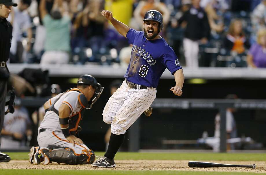 Michael McKenry scores the Rockies' winning run in the day's full game. Photo: David Zalubowski, Associated Press