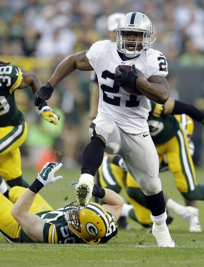 Oakland Raiders running back Maurice Jones-Drew (21) breaks away from Green Bay Packers inside linebacker A.J. Hawk (50) for a touchdown run during the first half of an NFL preseason football game Friday, Aug. 22, 2014, in Green Bay, Wis. (AP Photo/Tom Lynn) Photo: Tom Lynn, Associated Press
