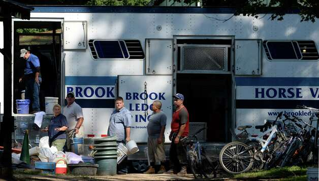 Workers for the Mark Henig racing stable load up a horse van as stables move to their new homes at tracks elsewhere on closing day Sep. 1, 2014 at the Saratoga Race Course in Saratoga Springs, N.Y.    (Skip Dickstein/Times Union) Photo: SKIP DICKSTEIN