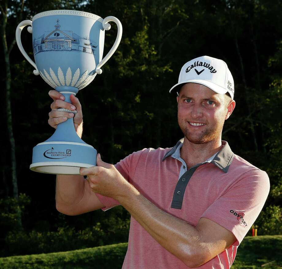 Chris Kirk holds up the trophy after winning the Deutsche Bank Championship golf tournament in Norton, Mass., Monday, Sept. 1, 2014. (AP Photo/Michael Dwyer) ORG XMIT: MAMD113 Photo: Michael Dwyer / AP
