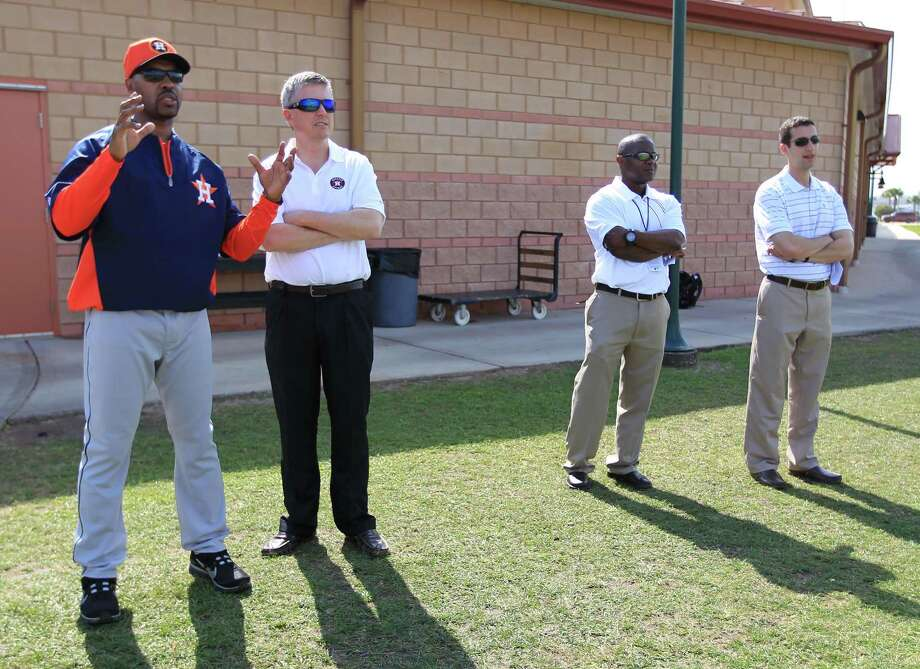 Astros manager Bo Porter talks with general manager Jeff Luhnow as they watch pitchers at Oseola County Stadium on the first day of spring training in February 2013. Photo: Karen Warren, Staff / © 2013 Houston Chronicle