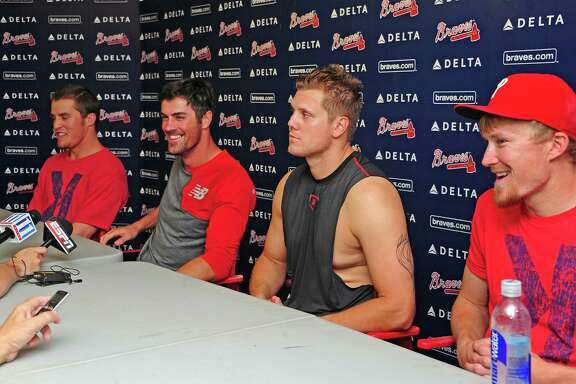 Phillies pitchers, from left, Ken Giles, Cole Hamels, Jonathan Papelbon and Jake Diekman were the men of the hour Monday after combining on the season's fourth no-hitter in a 7-0 victory over the Braves. Hamels, the starter, went six innings.
