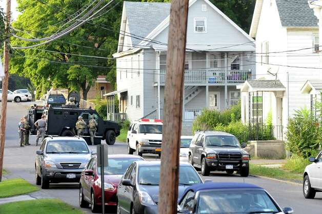 State Police use an armored vehicle during a standoff with a man in the second floor of a house on the corner of Grace Street and Vanderwerken Avenue, center, on Monday, Sept. 1, 2014, Waterford, N.Y. (Cindy Schultz / Times Union) Photo: Cindy Schultz
