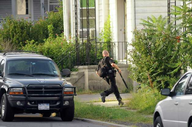 Saratoga County Sheriff officer gets into position on Grace Street as he prepares to evacuate neighbors during a standoff on Monday, Sept. 1, 2014, Waterford, N.Y. (Cindy Schultz / Times Union) Photo: Cindy Schultz