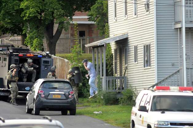 State Police help a downstairs neighbor evacuate during a standoff at at house on the corner of Grace Street and Vanderwerken Avenue on Monday, Sept. 1, 2014, Waterford, N.Y. (Cindy Schultz / Times Union) Photo: Cindy Schultz