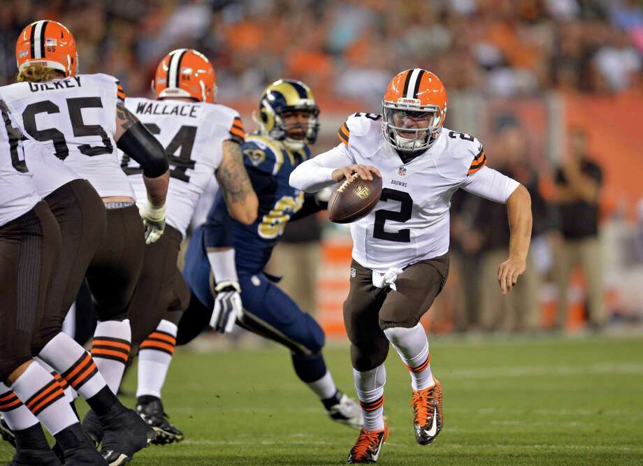 FILE - In this Aug. 23, 2014, file photo, Cleveland Browns quarterback Johnny Manziel (2) runs seven yards for a touchdown in the third quarter of a preseason NFL football game against the St. Louis Rams in Cleveland. Manziel doesn't view himself as the Browns' savior, but almost everyone else does. The dynamic rookie quarterback will begin the season as Cleveland's second-string quarterback, but it may not be long before he's moved ahead of Brian Hoyer, who already seems to be looking over his shoulder. (AP Photo/David Richard, File) ORG XMIT: CD205 Photo: David Richard / FR25496 AP