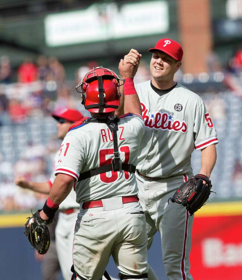 Philadelphia Phillies relief pitcher Jonathan Papelbon (58) celebrates with catcher Carlos Ruiz (51) after getting the final out in the ninth inning of a baseball game against the Atlanta Braves Monday, Sept. 1, 2014, in Atlanta. Papelbon combined with Cole Hamels, Ken Giles, and Jake Diekman for a no hitter. (AP Photo/John Bazemore)  ORG XMIT: GAB110 Photo: John Bazemore / AP