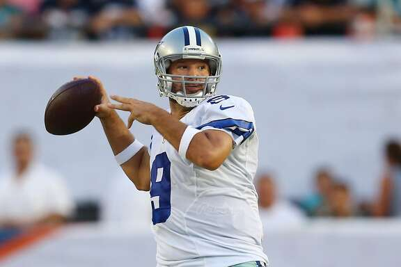Dallas Cowboys quarterback Tony Romo (9) looks to pass during the first half of an NFL preseason football game against the Miami Dolphins, Saturday, Aug. 23, 2014 in Miami Gardens, Fla. (AP Photo/J Pat Carter)
