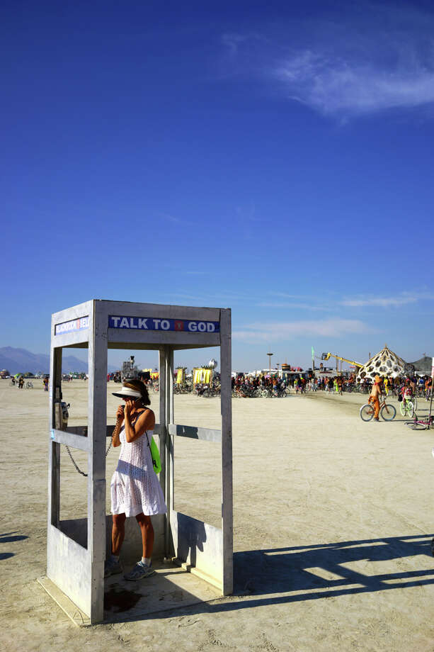 Delighted to see God make a return to the playa this year, offering free advice, insights, perspective. I took a snapshot of an ex-GF in this fine booth nearly 10 years ago. We used in her first book. Burner life is sort of cool that way. Photo: Mark Morford