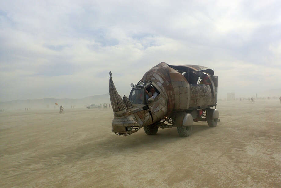 Does a little dust stop Redemption Rhino? Hell no. Does it stop true Burners from going out into the madness like a baller and coating yourself in the playa's finest alkali, fearless and feral, inhaling the madness into every pore and cell? Hell, no. Quit whining and dive in. The rhino would want it that way. Photo: Mark Morford